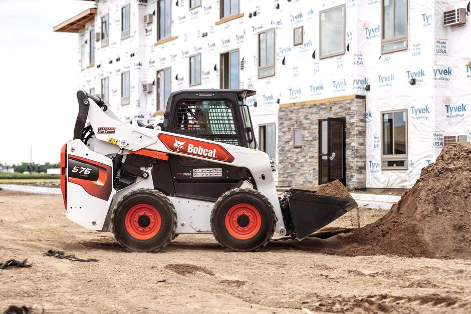 Operator Using R-Series Skid-Steer Loader To Move Material On Construction Jobsite