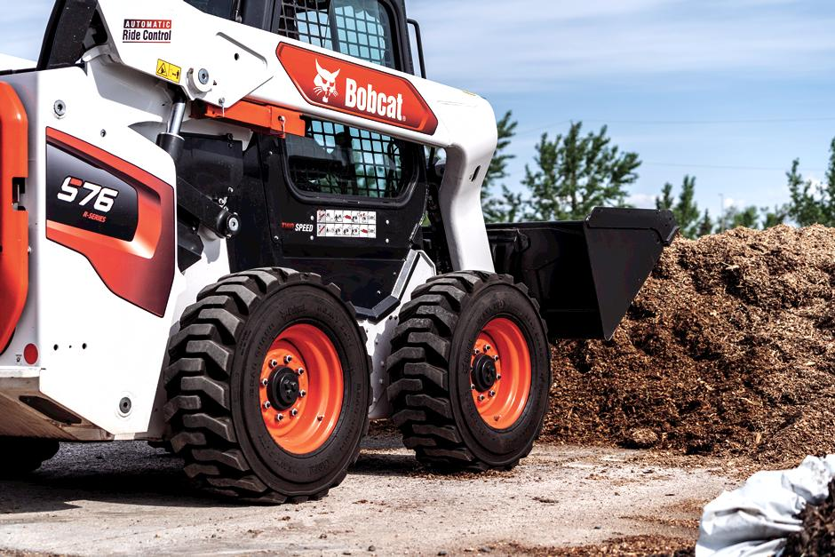 R-Series S76 with bucket attachment loading dirt.