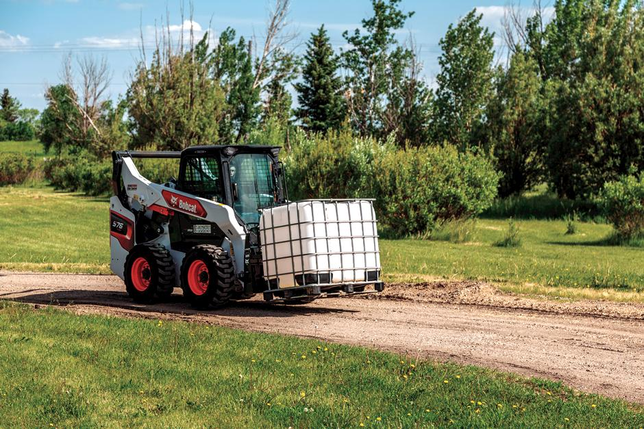 Bobcat S76 Skid-Steer Loader with pallet fork attachment.