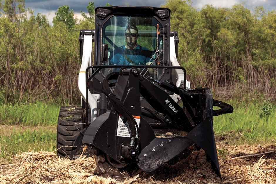 Operator Using Skid-Steer Loader To Grind Stump