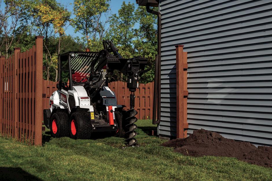 Bobcat Small Articulating Loader Drilling With Auger Attachment