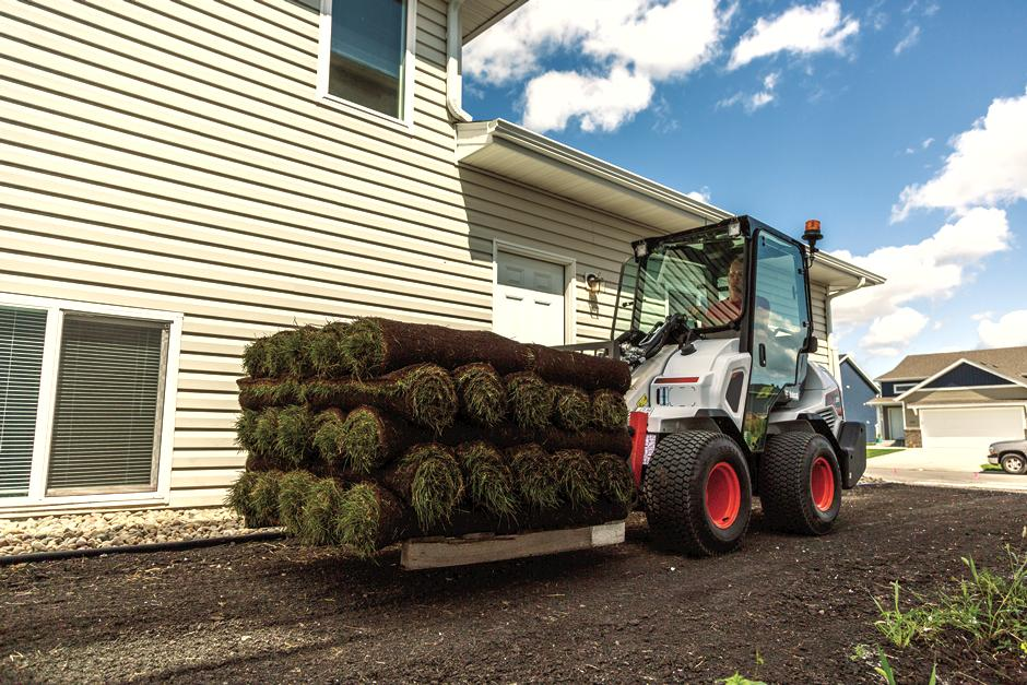 Bobcat Articulating Loader Lifting Sod with Fork Attachment
