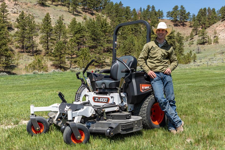 Professional Bull Rider Jess Lockwood Stands Next To His Bobcat Zero-Turn Mower.