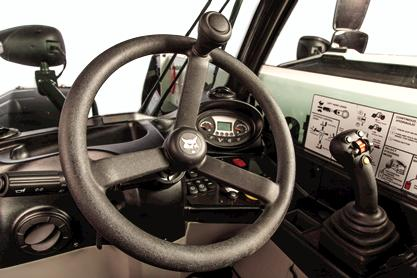 The controls and instrument panel inside the VersaHANDLER V519 telehandler.