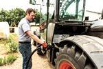 Operator filling a Bobcat V723 VersaHANDLER with diesel fuel.
