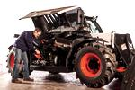 Operator performs maintenance on a V519 telehandler.