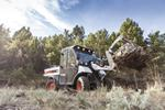 A Toolcat™ 5600 utility work machine clears brush.