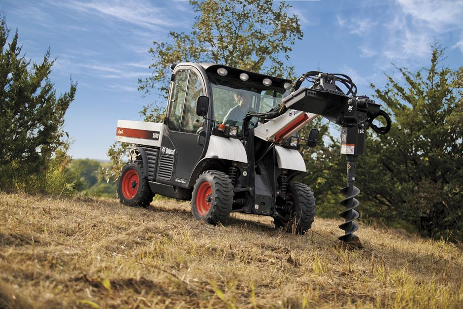 Bobcat 5600 Toolcat Utility Work Machine Drilling With An Auger Attachment