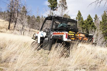 Bobcat utility vehicle in the grasslands.