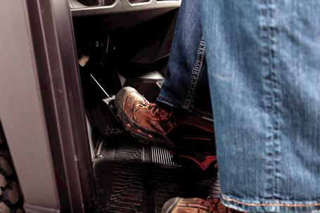 Operator's Foot On The Clutch Of A Bobcat Utility Vehicle (UTV)