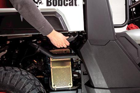 Bobcat Utility Vehicle (UTV) owner maintaining vehicle