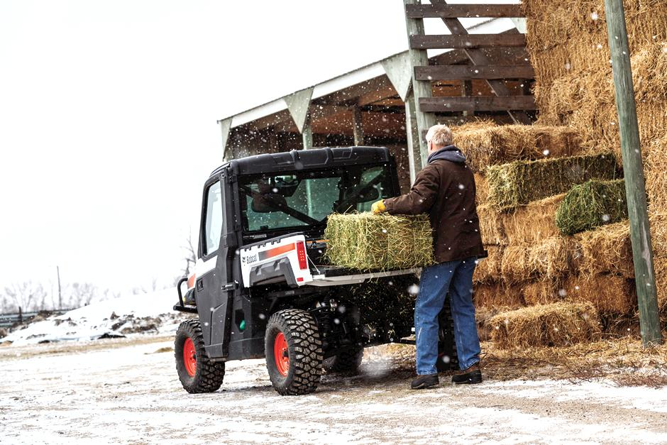 Bobcat Customer Loads Haybales In UTV Cargo Box