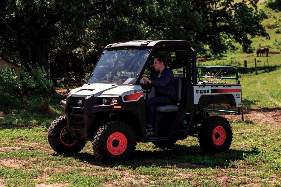 Farmer Uses Utility Vehicle With Common Tires In Pasture