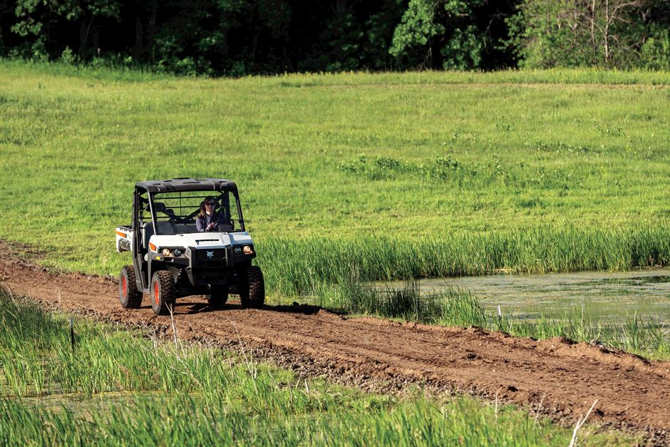 Bobcat Customer Driving UTV With All-Wheel Drive On Dirt Path