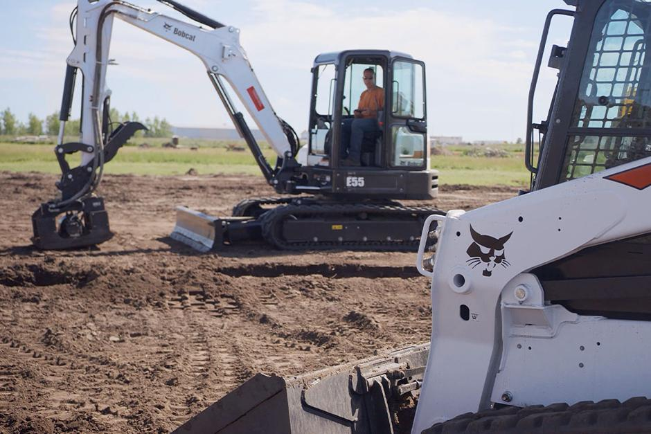 Bobcat operator uses the Bobcat MaxControl to fill in a trench