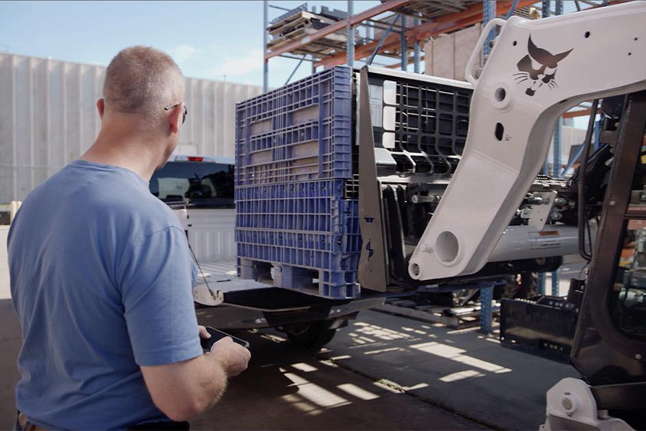 Bobcat operator uses the Bobcat MaxControl to load a truck