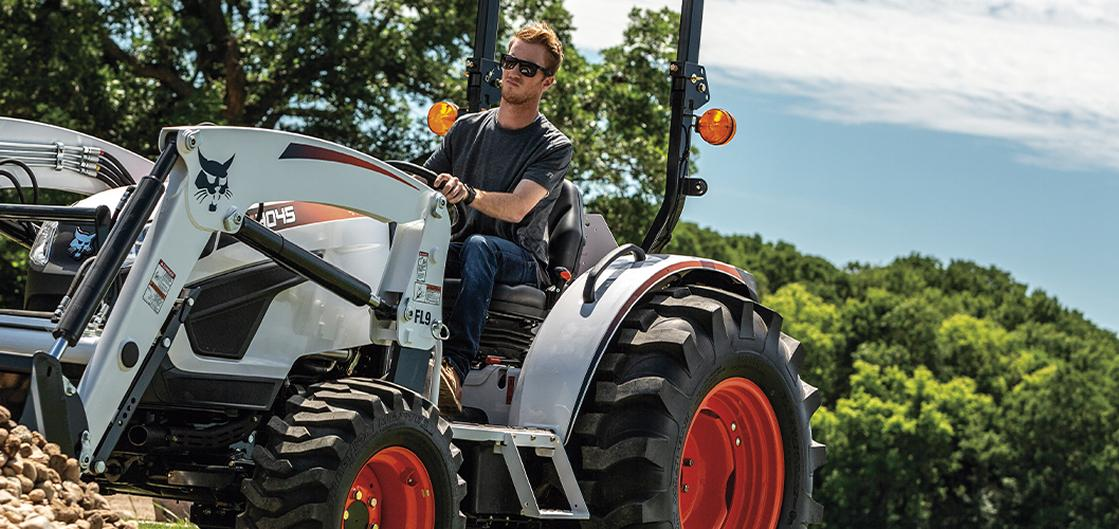 Customer using a Bobcat Compact Tractor 4045 on his land