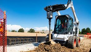 Bobcat Skid-Steer Loader With Auger Attachment Drilling A Caisson
