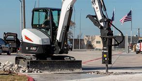 Operator Using Bobcat E50 Mini Excavator With Nitrogen Breaker Attachment To Break Up Concrete