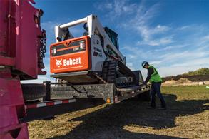 Operator chains Bobcat T740 to trailer