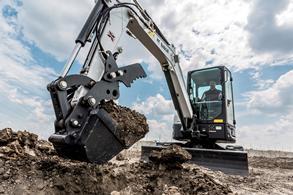 Bobcat E35 compact excavator works on a construction jobsite.