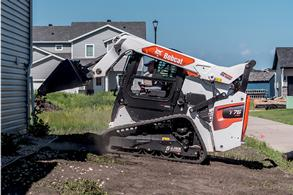Bobcat skid-steer loader with bucket attachment