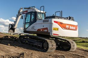 Bobcat Large Excavator Digs In Field With Bucket Attachment