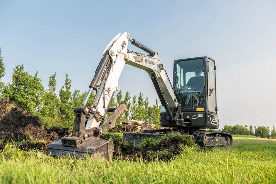 Operator Digs A Hole With A Bobcat E35 Mini Excavator And The Depth Check System
