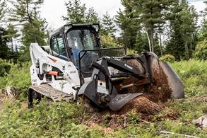 Bobcat T650 compact track loader with a stump grinder attachment.