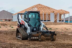 R-Series Compact Track Loader And Bobcat Soil Conditioner Attachment Work At A Construction Site