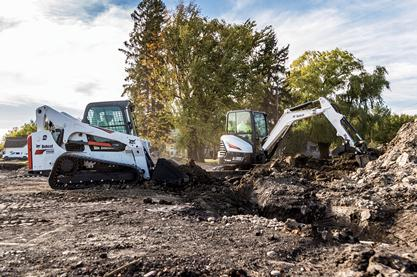 A Bobcat compact track loader and compact excavator working together on a jobsite.