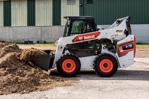 Bobcat Skid-Steer Loader moving dirt