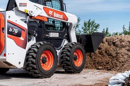 Skid-steer pushing dirt.