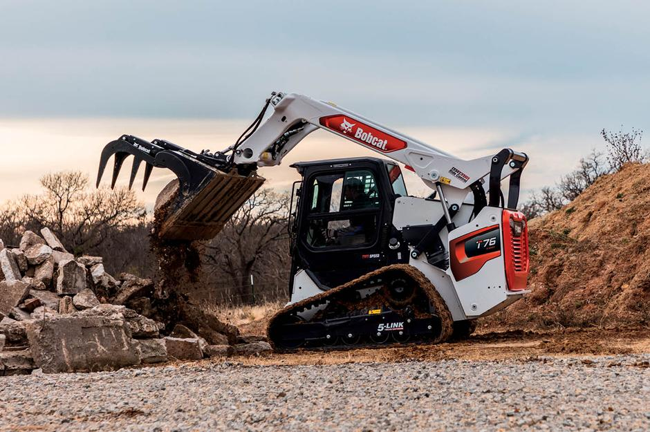 R-Series T76 compact track loader moves broken concrete with an industrial grapple.