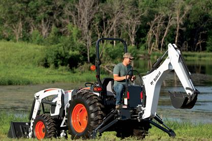 Bobcat compact tractor with front-end loader attachment and backhoe attachment.