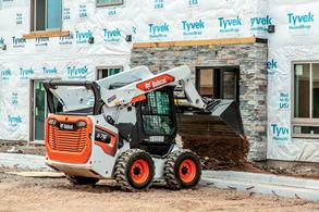 Skid-steer compact loader with vertical lift