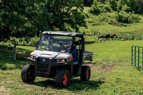 Livestock Farmer Drives Through Pasture In Bobcat Side-By-Side UTV