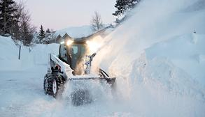 Bobcat Skid-Steer Loader Clears Snowdrift With Snowblower Attachments