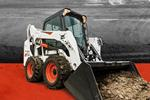 Bobcat S590 skid-steer loader and bucket attachment.