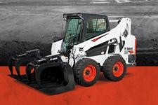 Bobcat S595 skid-steer loader and bucket attachment.