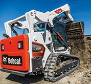 Operator Using Bobcat T595 Compact Track Loader With Bucket Attachment To Add Dirt To Pile On Construction Site