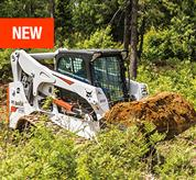 Bobcat T770 compact track with a bucket carrying dirt across a jobsite.