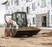 R-Series Skid-Steer Loader From Bobcat Hauling Dirt