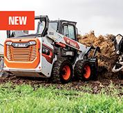 R-Series Skid-Steer Loader With Grapple Attachment on the Farm