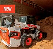 R-Series Skid-Steer Loader With Bucket Attachment Lifting Sand