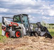 R-Series Skid-Steer Loader with Stump Grinder Attachment