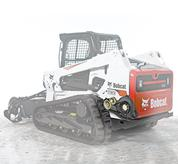 Transverse engine and belt drive on Bobcat loaders.