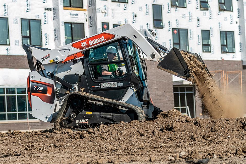 Bobcat Compact Track Loader Hauling Dirt On Apartment Construction Jobsite