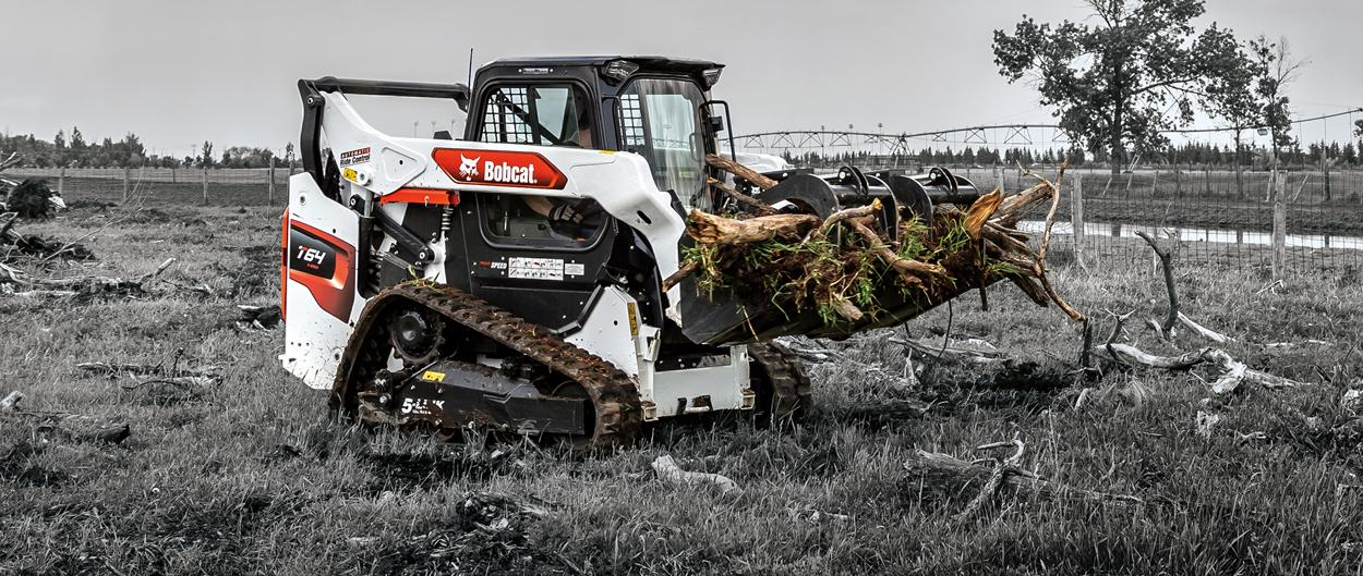 Bobcat T64 Compact Track Loader with grapple attachment