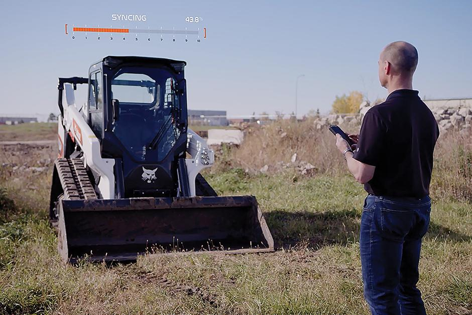 Bobcat Dealer Using A Smartphone To Add A Feature To A Compact Track Loader